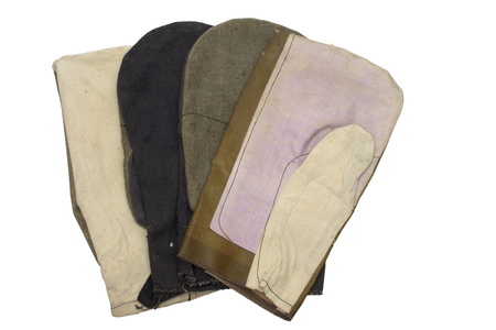 Set of work gauntlets. one-finger gloves for welders (leather top), laborers and riggers (colored and white, cotton top). Stock Photo