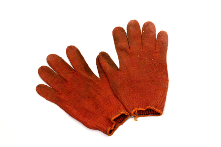 pair of orange-red working knitted gloves, turned inside out. Stretchy orange hem. Bright spot through labor. with clipping pass Stock Photo