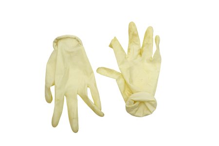 disposable surgical gloves, removed from hands. cuff is twisted, rubber damaged and unsterile. isolated on white background, with clipping path