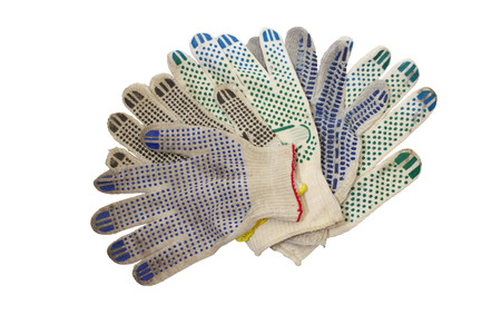 heap of cotton colorful working gloves with rubber dots, beautifully arranged by palms-up, isolated on white background with clipping path Stock fotó