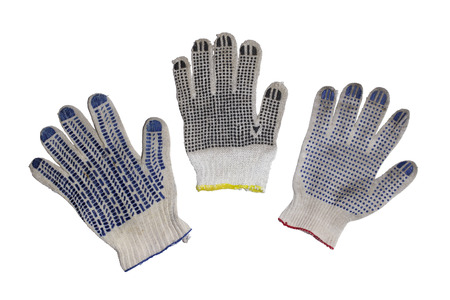 protective gloves for maual labor, with different forms of rubber dots on working side and multicolored borders of cuff. isolated on white background, with clipping path