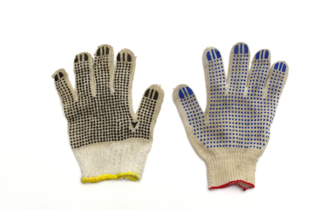 similar working gloves, with colored dotted surface, isolated on white background, with clipping path