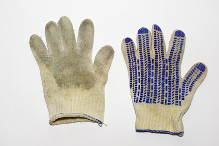 pair of dirty gloves for gardening. dotted anti-skid surface. elastic cuff. blue hem. from both sides
