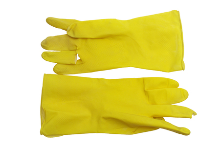 yellow rubber gloves for dishwashing and sanitary home cleaning. hand protecting at work with caustic cleaners. isolated on white background, with clipping path