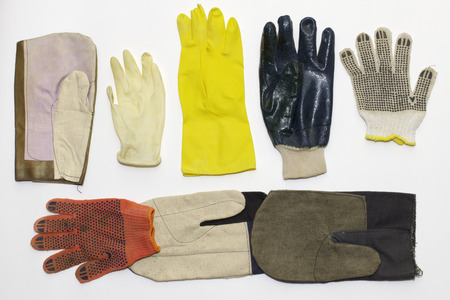 mix of working protective gloves: textile (for gardening, with rubber dots, nitrile coated); rubber (for cleaning (long), medical); and mittens (for gripping work, for welders (with brown leatherette))