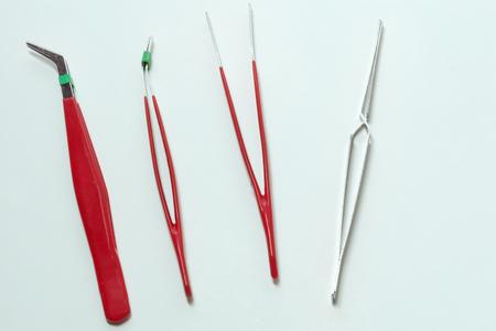 Professional tweezers set for precision work, repairing mobiles, with red antistatic handles Stock fotó