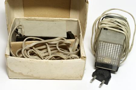 vintage impulse camera flash unit in original cardboard box Stock fotó