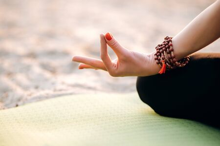 Close up photo of female hand during yoga class, outdoors
