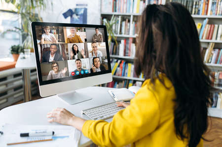 Multiracial business people gathered together in online video conference talk discuss financial strategy, colleagues have distant webcam conference on laptop