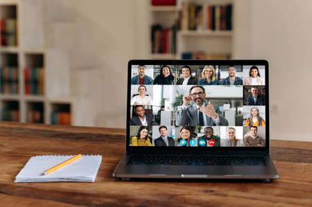 Virtual meeting.View at laptop screen with group of business people of different nationalities gathered from different parts of the world for communication and discussion business issues by video call