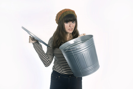 Disgusted Girl Holding Metal  Trash Can Stock Photo