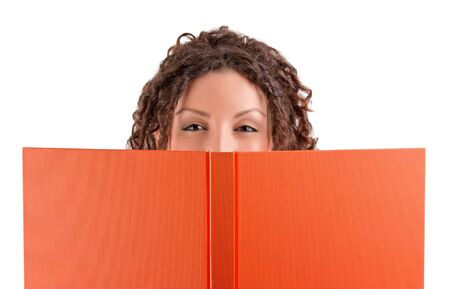 Smiling young student holding a book Stock Photo
