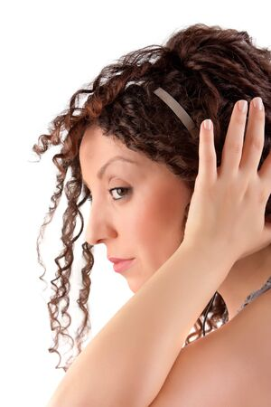 Young girl holding headphones listens calm music.