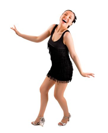 Young and beautiful girl dancing in black dress. Stock Photo