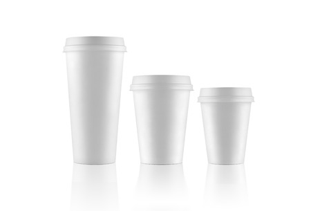 Set of white take-out coffee cups on white background with various sizes photo