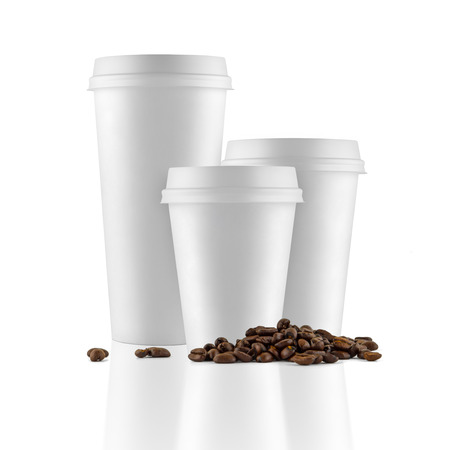 Set of white take-out coffee cups and coffee beans on white background Stok Fotoğraf