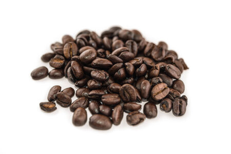 Close up handful of coffee beans on white background