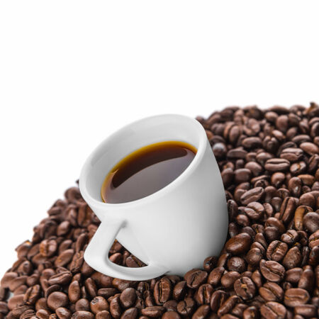 Cup of coffee with coffee beans on white background