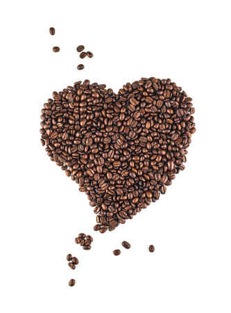 Heart shaped coffee beans on white background Stock Photo