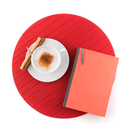 Cup of coffee and book on white background