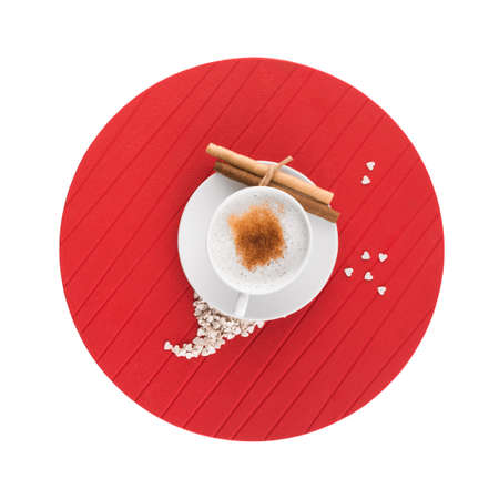Cup of coffee and candy assortment on white background
