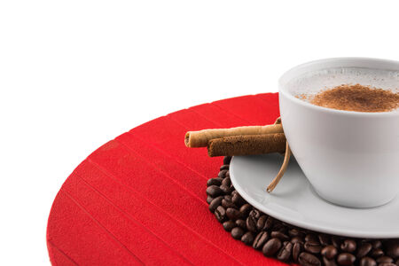 Close up view cup of coffee with coffee beans assortment on white background