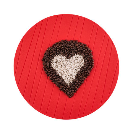 Heart shaped coffee beans and candies on white background Stock Photo