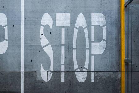 White stop traffic sign over asphalt lane. Stock Photo