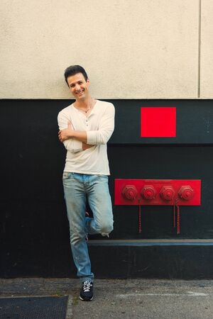 lean back: Handsome casual happy man lean back wall. Stock Photo
