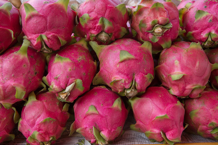 Dragon fruit on market in thailand photo