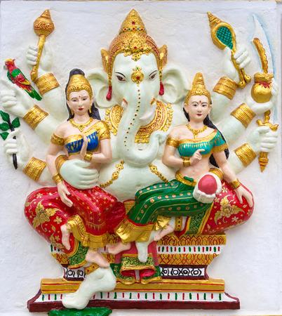 worshipping: Ganesh isolated on white (God Success fo Hindu)