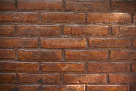 worn structure red: brick wall in a close up Stock Photo