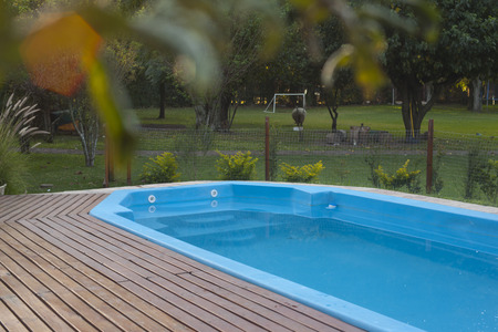 teck: residence with swimming pool and deck. Surrounded by fence