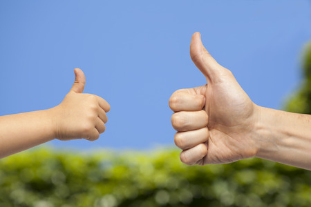 manos: father and son hands giving like on natural background Stock Photo