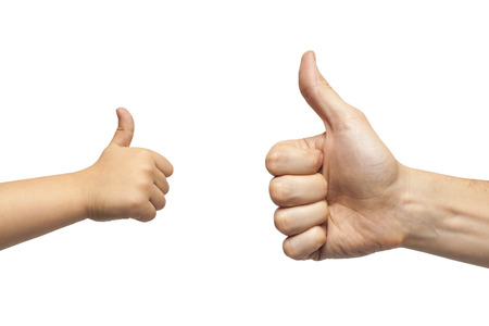 manos: father and son hands giving like on white background