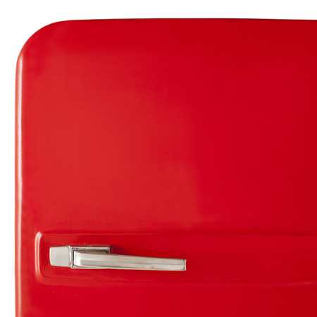 Old red vintage refrigerator isolated on white background