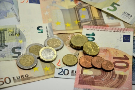 sorted: Photo bakground with euro currency banknotes and sorted stocked coins Stock Photo