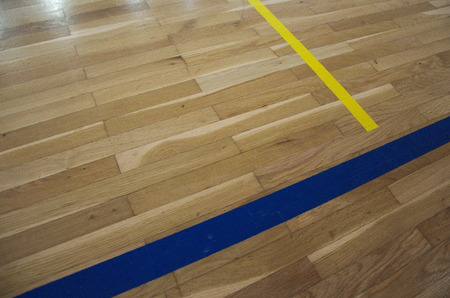 echange: Close up photo of old parquet with lines in school sport gym. Old wooden parquete prepared for renovation or echange for new one. Sport building floor.