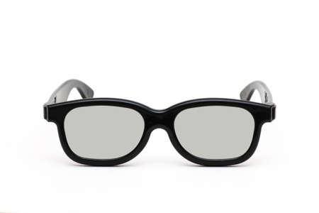 Front view of black plastic glasses to watch films in 3D format isolated close up on white background photo