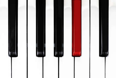 Close up of black, white and one red piano keys Stock Photo