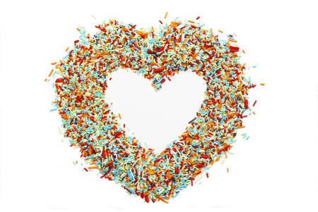 Close up of colourful candy sticks heart isolated on white background Stock Photo