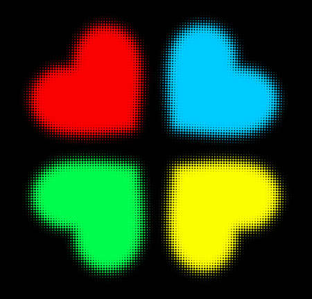 Four halftone hearts in different colours on black background photo