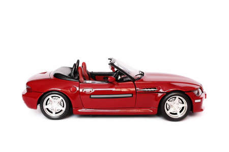 Red BMW convertible toy car on white background