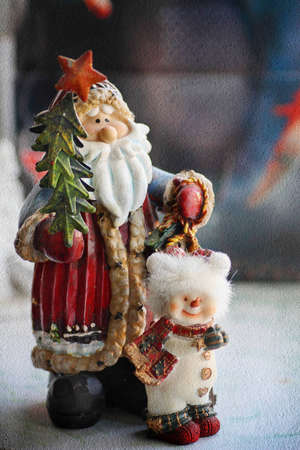 Christmas decorations santa claus and snowman standing together with texture