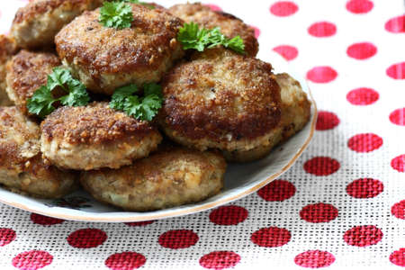 Homemade roasted beef burgers laid in a heap on a plate Stock Photo
