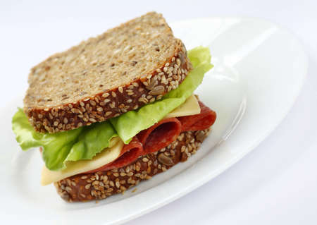 Sandwich made of healthy brown bread with seeds  lettuce italian salami and cheese Stock Photo - 14004081