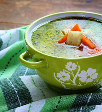 bouillon: Home made chicken bouillon with vegetables in bowl Stock Photo