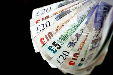 Fan of british pounds sterlings in five ten and twenty notes Stock Photo