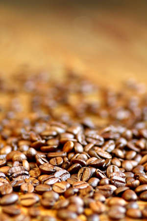 Close up of scattered roasted coffee beans Stock Photo