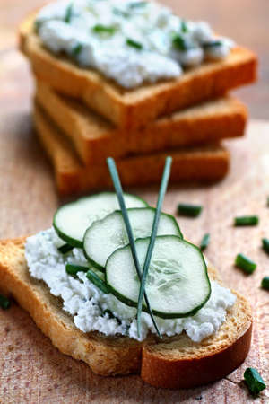 Close up of rusk spread with cottage cheese and chives